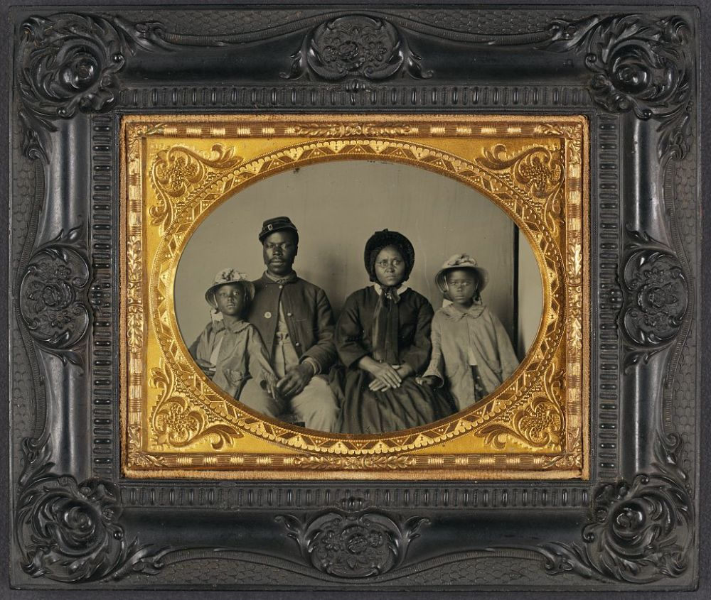 Unidentified African American soldier in Union uniform with wife and two daughters