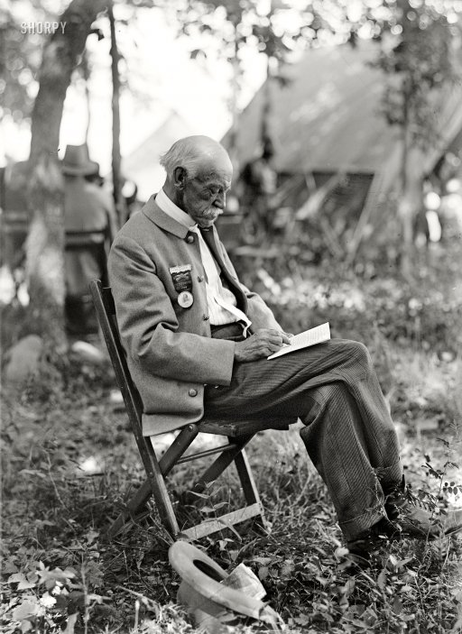 """July 1913. """"Gettysburg reunion: Veterans of the G.A.R. and of the Confederacy, at the Encampment."""" Harris & Ewing glass negative."""