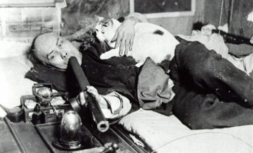 Man smoking opium with his cat