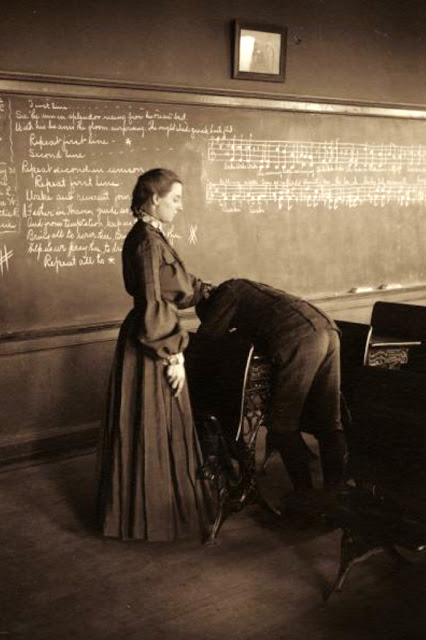 A school teacher lashing a boy student over a desk, Menomonie, Wisconsin, 1905